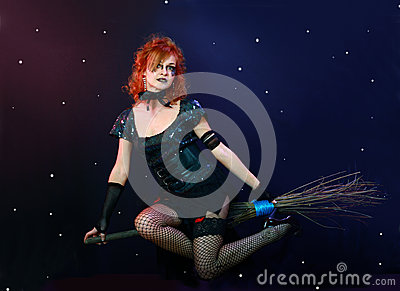 Red hair witch flying on broom