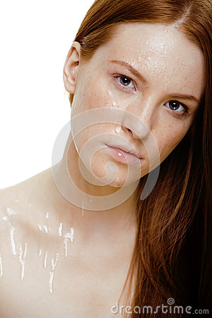 Red hair woman with drops on her face