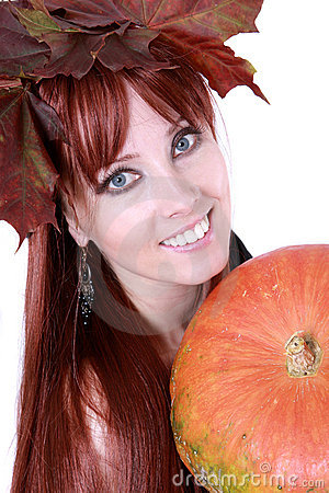 Red hair woman with pumpkin