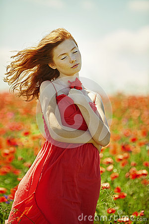 Free Red Haired Beautiful Girl In Poppy Field Royalty Free Stock Image - 70076326