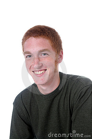 Red haired boy with freckles and a smile