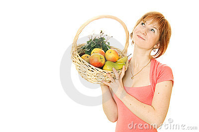 Red-haired caucasian woman with fruits