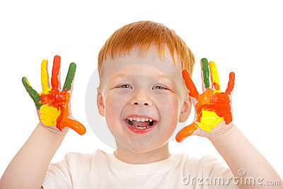 Red-haired child hands painted in bright colors