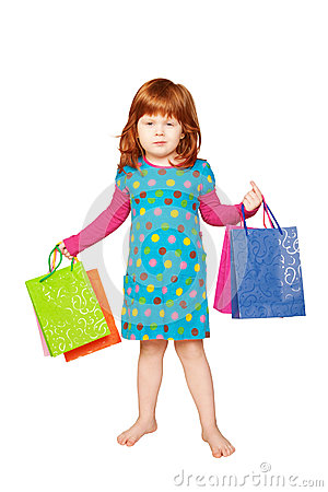 The red-haired child with shopping bags