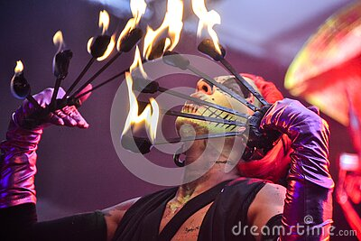 Red Haired Fire Dancer Blowing Rod With Flames Free Public Domain Cc0 Image