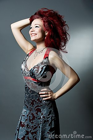 Red haired girl with brilliant smile