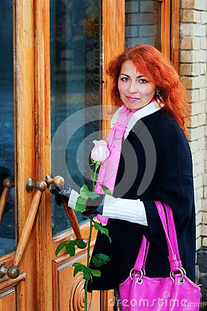 Red haired girl entering the door