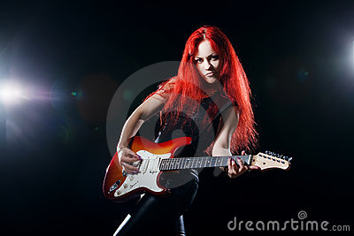 Red-haired girl the guitarist