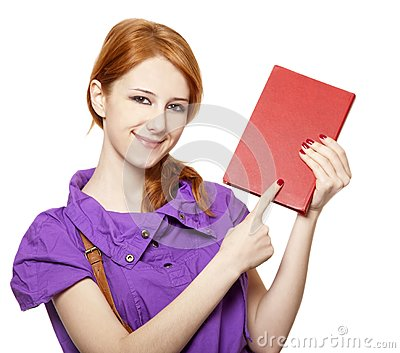 Red-haired girl keep book in hand.