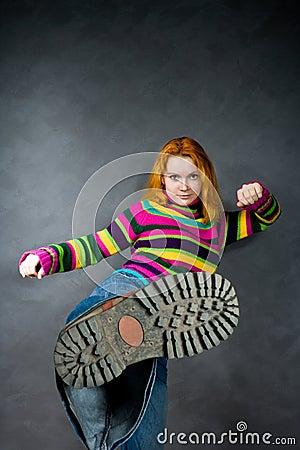 Red-haired girl kicks