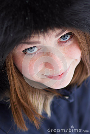 Red haired girl outdoors in winter