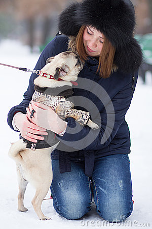Red haired girl with pug dog