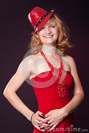 Red-haired girl in a red dress and red hat