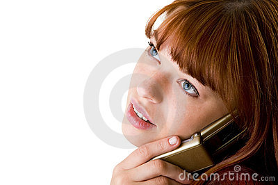 Red haired girl speaking on cell phone close-up