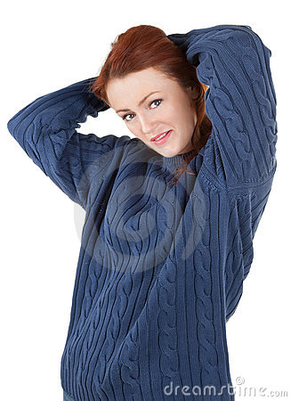 Red-haired girl is trying to keep warm