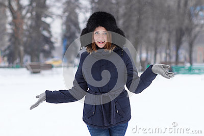 Red haired girl in winter outdoors