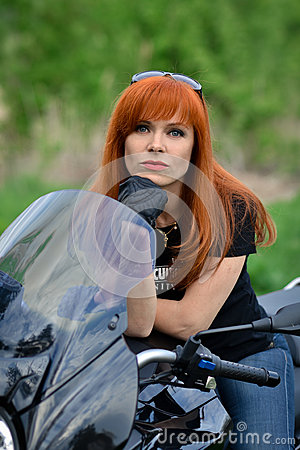 Free Red-haired,serious,angry,calm,powerful Woman In Black Royalty Free Stock Image - 68985296