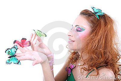 Red-haired woman with butterflies