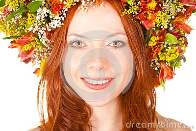 Red haired woman closeup smiling face portrait