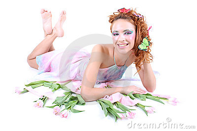 Red-haired woman with flowers lying