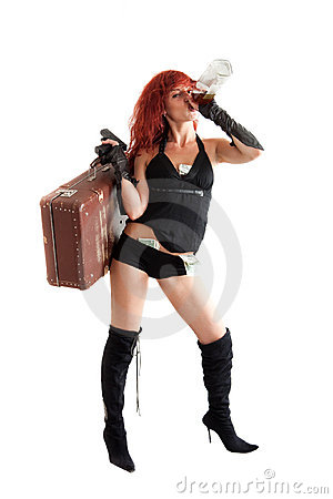 Red-haired woman with gun and money drinks alcohol