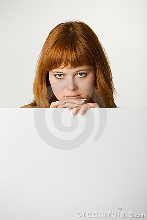 Red haired woman with sign