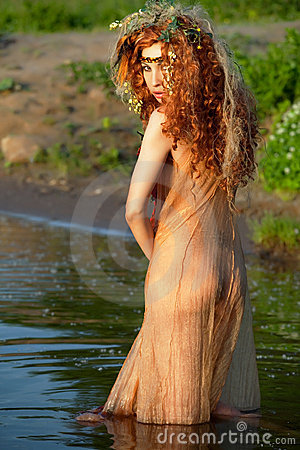 Red-haired woman in a transparent dress.