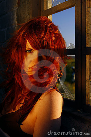 Red haired woman at window
