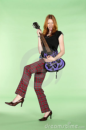 Red Head Rock and Roll Guitar Player with Leg Up