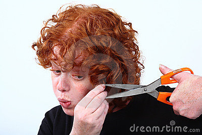 Red head woman cutting hair