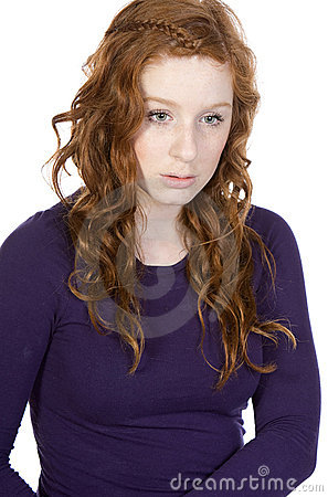 Red Headed Teen Looking Sad against White