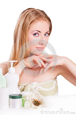 Red-headed woman with skincare and nail products