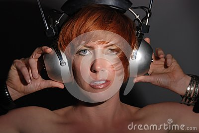 Red headed woman with vintage headphones