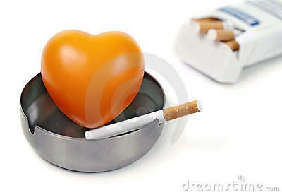 Red heart in the ashtray and cigarettes.