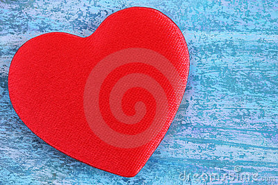 Red heart on a blue abstract background