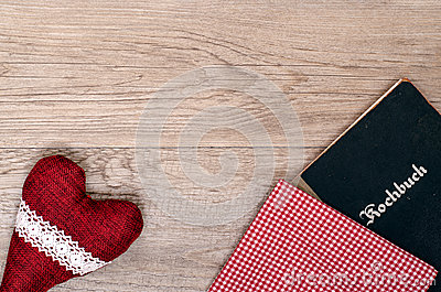 Red heart with checkered cloth and book