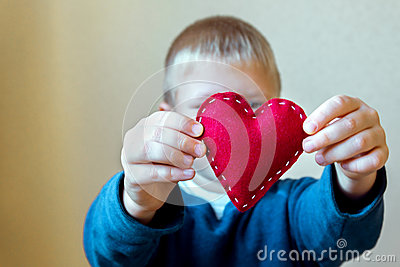 Red heart in child hands Stock Photo