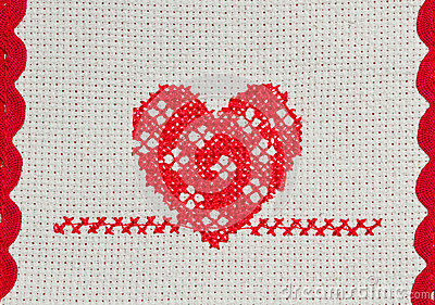 Red heart embroidered in cross stitch