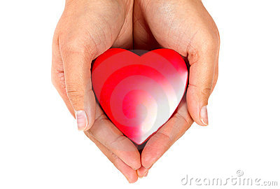 Red heart in female hands