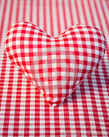 Red heart on gingham tablecloth
