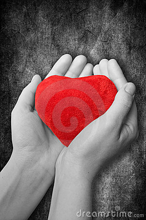 red heart in hands