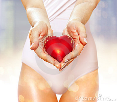 Red heart on hands