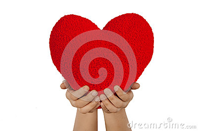Red heart with hands made from wool isolated on wh