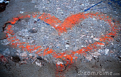 Red heart painted on concrete