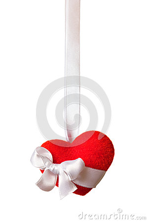 Red heart with a ribbon isolated on white