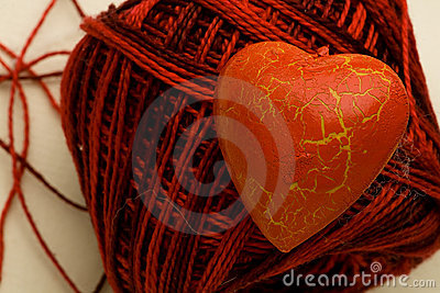 Red heart shape on cotton clew ball