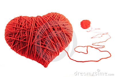 Red heart shape symbol made from wool