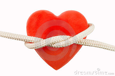 Red heart-shaped candle and a rope