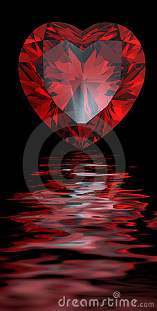Red heart shaped garnet reflected on water