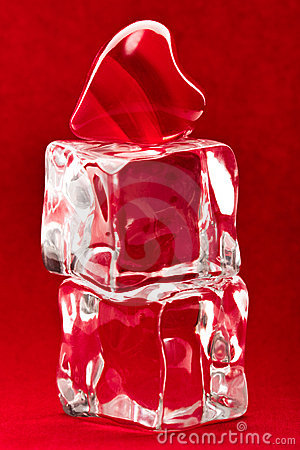 Red heart on two ice cubes